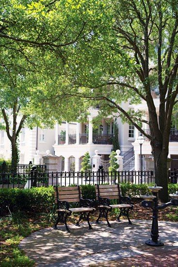 Not only have Charleston's historic buildings been preserved, like this nineteenth-century home on Battery Park, but its run-down neighborhoods have been carefully resurrected.