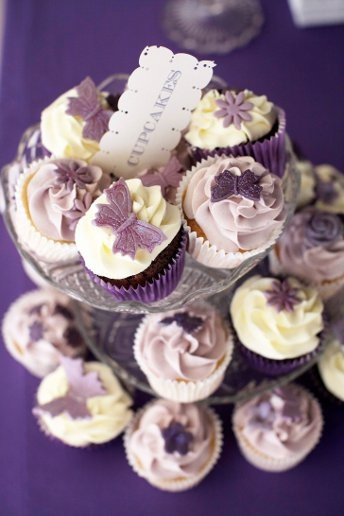 Keep your colour theme going with your cake. We love these cupcakes in various shades of purple!  Photography: Laura Dodsworth Photography