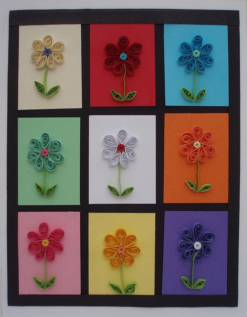Quilling ...another good basic project for 7th grade.  It looks like a Quilling Warhol. The flowers would be cute with a button as their center, too. I'll have to think of other simple shapes, that could appeal to the boys, though. They're not going to want to do flowers.