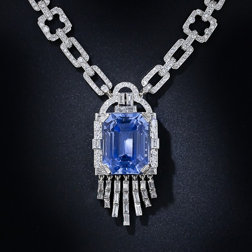 A rare, radiant and ravishing Art Deco necklace, circa 1930, by the eminent Madrid, Paris and London joaillier - Lacloche Frères, starring a gorgeous, serene cornflower blue sapphire with diamond like purity.