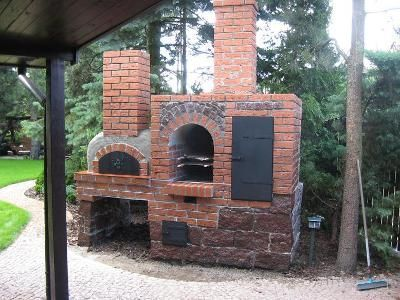 great brick outdoor oven with a wood fired oven and smoker.: