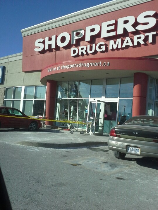 Shoppers Drug Mart at King and Park in Oshawa. Somehow a lady drove into the front of the store.