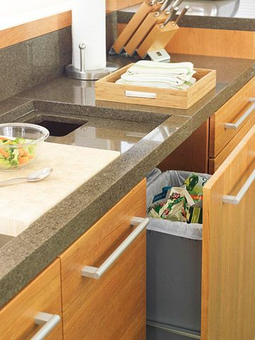 A Cook's Kitchen:  The DuPont Zodiaq quartz-surfacing counters.  Slide the inset cutting board aside and swipe food debris directly through the counter into the double wastebasket pullout.