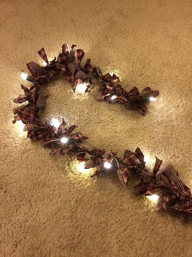 How To Make Rag Light Garland...I made these using homespun fabric for one Christmas tree with rusty star ornaments, and also red and white checked on white light wire and used them as a swag over my white Priscilla curtains in my kitchen...they have no season and pretty year round