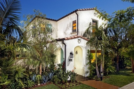 Lush Multi Layered Landscaping Surrounds This Spanish Style Stucco And Tile California Home