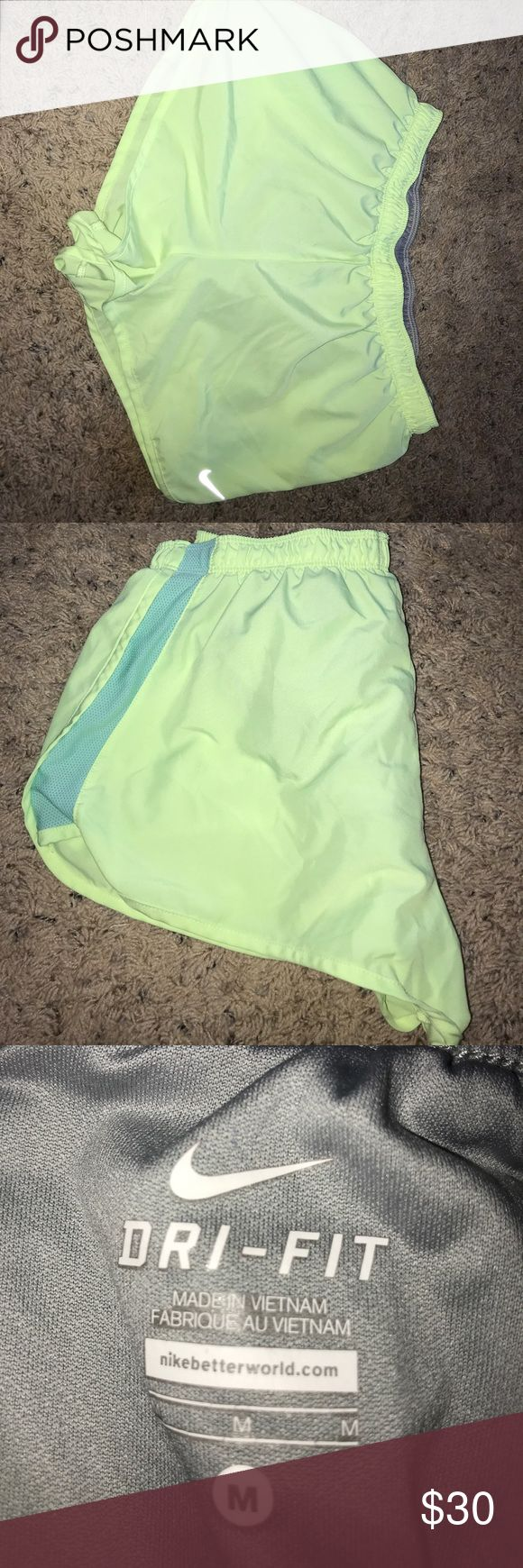 Nike dri-fit shorts lime green shorts w/ a blue mesh side. Super cute & great for running!! great condition slightly worn. Nike Shorts