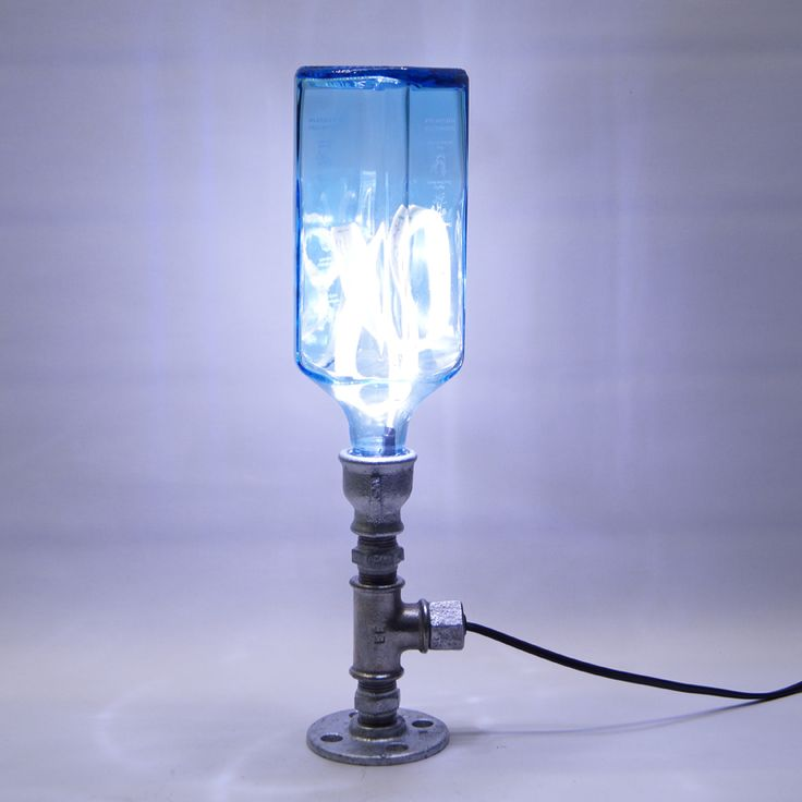 """Bottle lamp """"Bozinga"""" Handmade desk lamp made of 1/2 inch plumbing parts and blue glass bottle 12VDC power supply, switch and led strip included Equipped with 1m black cable Dimensions: 9x9x38cm , 2Kg Shipping in 5 working days €123.00"""