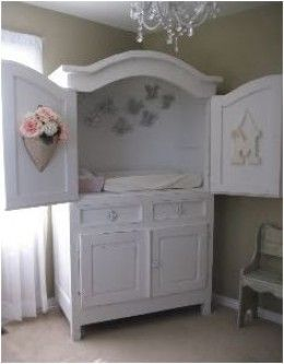 Old TV cabinet... changing table & nursery storage. - Could even put a tension rod (or 2) inside for extra hanging space. I imagine changing in such a closed-in space may be difficult.