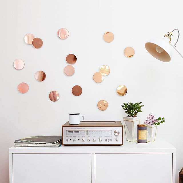 Copper metal wall decor makes a big impact in many different spaces. This unique wall decal is easy to install with peel and stick adhesive and will turn your blank walls into art.   Umbra Confetti Dots Wall Decor | Design by Laura Carwardine