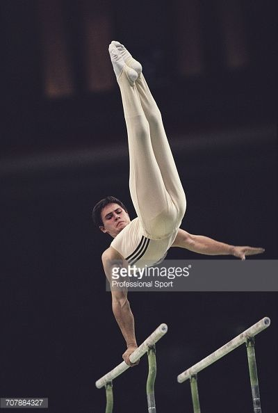 Russian gymnast Dmitry Bilozerchev , competing for the Soviet Union, pictured in action on the parallel bars during competition to win the bronze medal in the Men's artistic individual all-around...