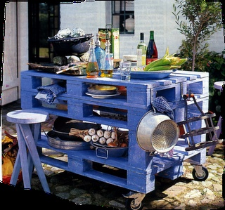 The site is in French, but there are some neat ideas for pallet furniture on it. I like this rolling outdoor island. Would be handy in the garage.