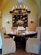 love these tufted slipcovered dining chairs