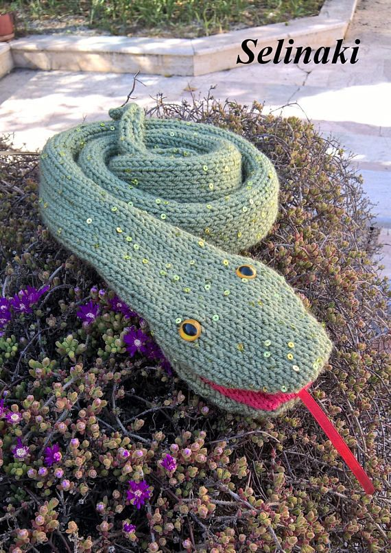 Hand knit snake scarf  Handmade by me with %100 acrylic yarns and has sequins.  Approximately 164 cm. (64.5 inches) long.  Ready to ship.  Thanks for looking and please contact me for any questions.   (Colors may appear differently in real life due to camera and monitor settings)