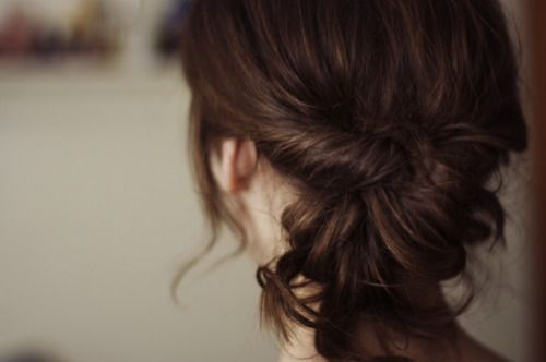"""A Twisty Ponytail:    1. Gather your hair very loosely in a low ponytail, away from your head a bit and secure with a hair tie.  2. Remember the """"topsytail""""? Well this part is sort of like that....only without the """"topsy"""". Stick your finger in your hair, just above the hair  tie, parting the hair in two sections. Thread the tip of the ponytail through the part you've created, creating a twist just above the ponytail.  3. Now be creative!! With the ponytail, you can secure a bun just under…"""
