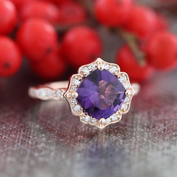 This vintage inspired engagement ring features a 8x8mm cushion cut natural purple amethyst set in a solid 14k rose gold floral diamond setting and
