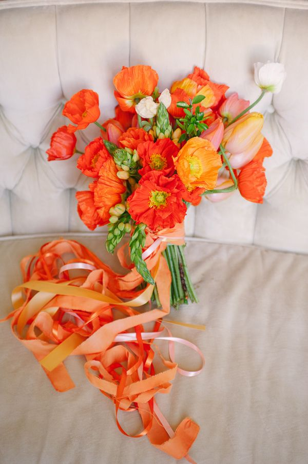 orange poppy bouquet, styling by Sarah Park Events, photo by Sweet Root Village http://ruffledblog.com/orange-crush-wedding-ideas #flowers #weddingbouquet #poppies