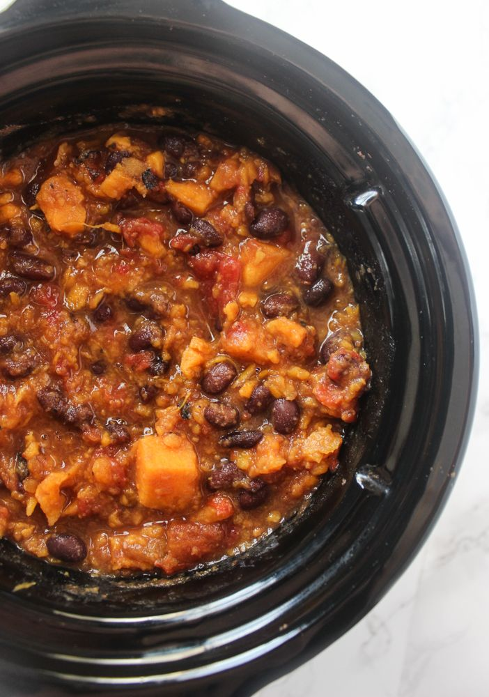 Slow Cooker Sweet Potato and Black Bean Chili is delicious served with cheese and sour cream on top! A meal the family will love coming home to.