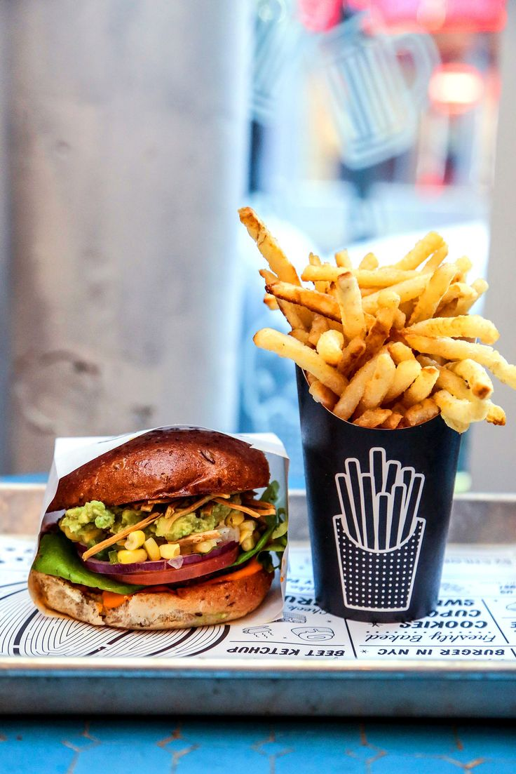 Burgers maintain a judicious level of squish without going to pieces. Here, the guac burger with French fries. (Photo: Krista Schlueter for The New York Times)