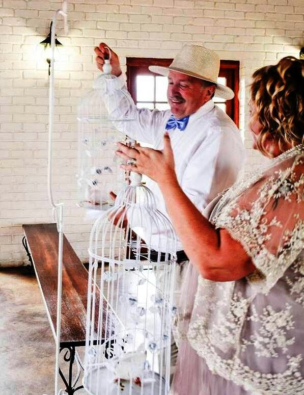 My wedding. White doves in birdcages. In the chapel on white birdcage stands.