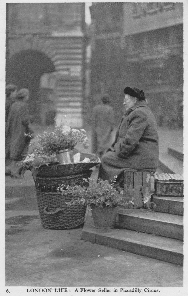 Flower seller in Piccadilly Circus, London