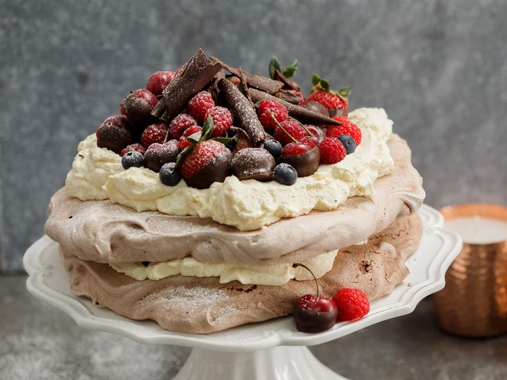 A twist on a Kiwi Christmas classic, this deliciously airy pavlova was created by Karla Goodwin of Bluebells Cakery using the deliciously improved NESTLÉ BAKERS' CHOICE chocolate baking range. It's perfect for a festive family celebration