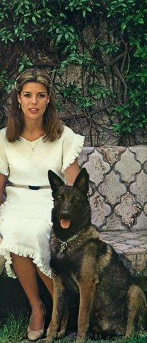 Caroline of Monaco in an adorable ruffle sleeved & hemmed white sundress with self belted waist.... ♡... Re-pin by StoneArtUSA.com ~ affordable custom pet memorials for everyone.