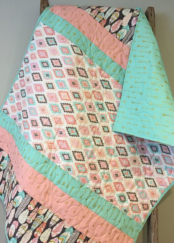 Aztec arrows feathers baby quilt, boho baby quilt, Baby Girl quilt, Aztec nursery, tribal nursery, boho nursery, pink aqua crib bedding This modern baby girl quilt features an aztec-inspired center print with coordinating arrows and feathers fabrics with metallic gold accents. The