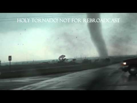 """It's amazing. Watch as the tornado forms and, then, grow into an absolute monster! If you can watch this in """"full screen"""", do it! This video is excellent, close enough to get """"the effect"""" but, not to close. I think these guys are pros. (Unfortunately, one person, presumably, in the trailer park, was killed)"""
