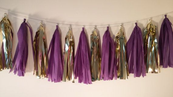 This listing is 12 Tassels on a shimmery 12 foot garland cord 6) Plum Purple 6) Metallic Gold My tassels are 15 inches long, longer and fluffier than any other tassels available for purchase.  I use high quality paper and keep our fringe at a luscious - fifteen inches - long. Your garland will come pre strung, but not tied, allowing you to customize their position, whether it be on either side of a dessert table, or maybe delicately floating above your guests heads. As you can see in picture…