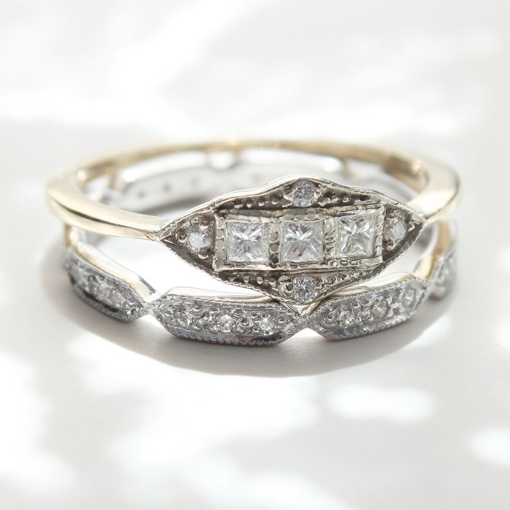 "One of Erica Weiner's very favorite rings from the ""Machine Age"" period served as the inspiration for this piece. Three square cut diamonds line up in a row in a solid 14k white gold face. Four tiny diamond surround them. The Machine Age Ring with Diamonds is a Catbird exclusive."