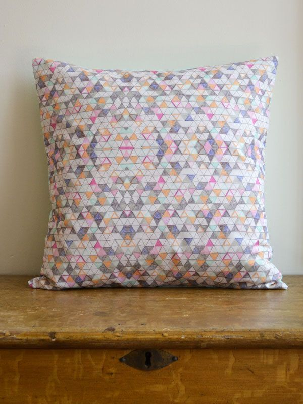 One of a kind, geometric illustrated cushion. From harrietgray, via Etsy.