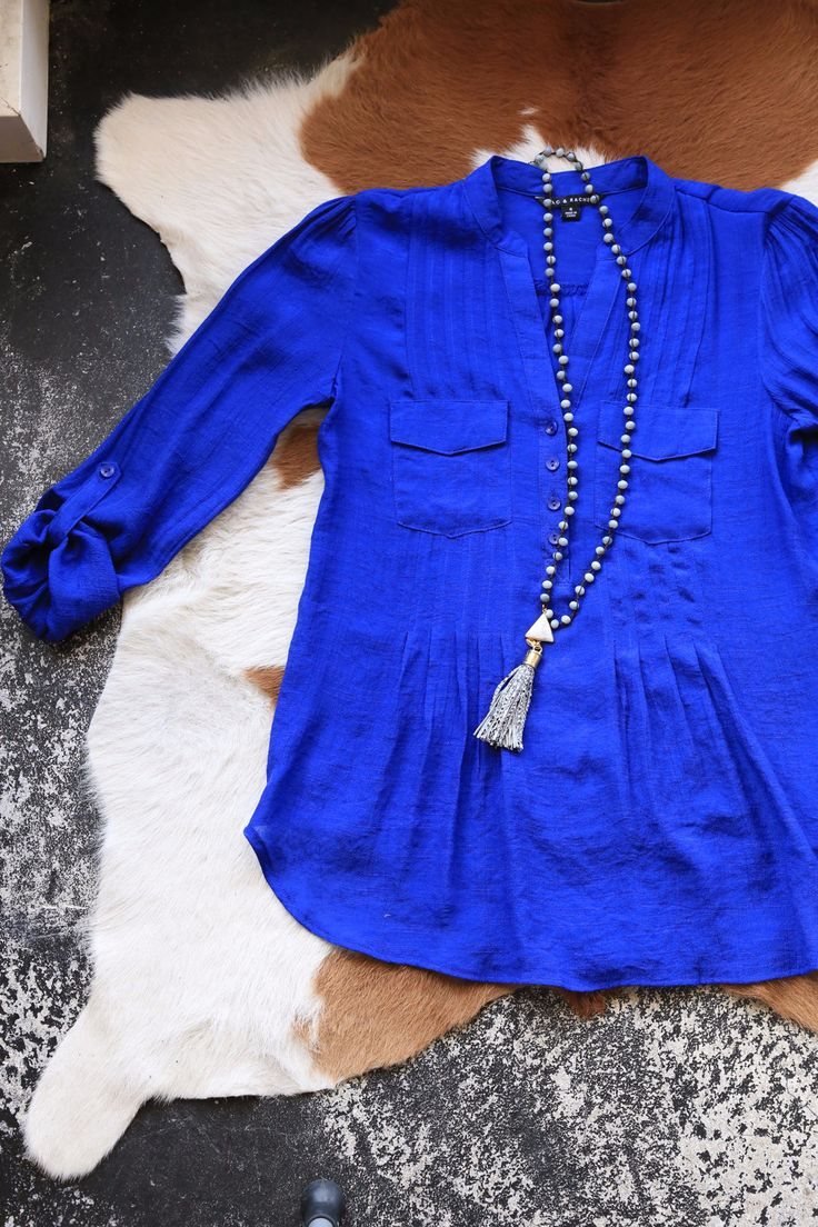 This royal blue blouse is light, flowy and fits in all the right places! With…                                                                                                                                                                                 More