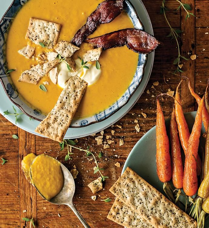 Roast pumpkin and carrot soup recipe - By FOOD TO LOVE, The gentle spices in this wholesome autumn soup warm up many a hungry worker and dinner guest alike. Fragrant but not too overwhelming, the pumpkin shines through so even my little Mr Fussy will eat it. Crumble Huntley & Palmers Mixed Herbs Flatbreads over the top and serve extra on the side for dipping.