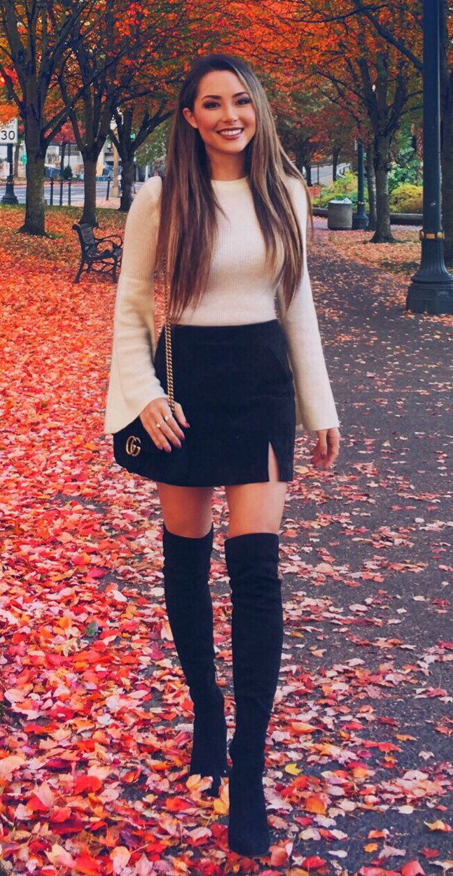 #fall #outfits women's white crew-neck long-sleeved sweat shirt and black mini skirt with pair of black knee-high boots and black and gold-colored Gucci crossbody bag #kneehighbootsoutfit