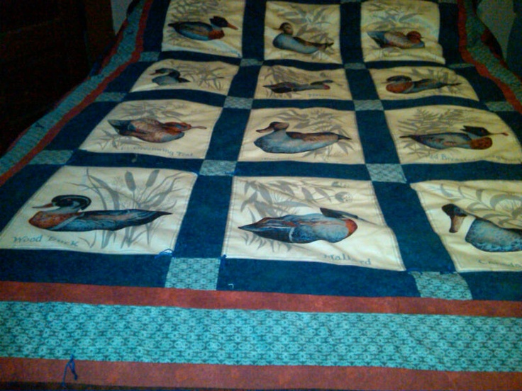 quilt made with fabric panels of ducks (for my camp)