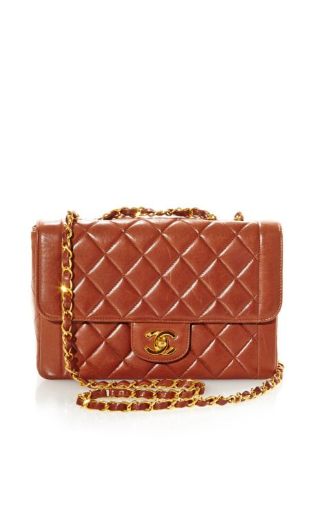 Vintage Chanel Brown Flap Bag From What Goes Around Comes Around by Vintage Chanel from What Goes Around Comes Around for Preorder on Moda Operandi
