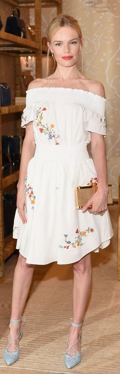 Who made Kate Bosworth's white skirt, off the shoulder top, gold clutch handbag, and lace up blue pumps?