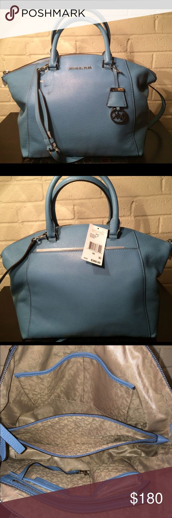 Michael Kors large sky blue Riley satchel tote My prices are lower throughⓂ️ercari and through ️️ Bags are 100% authentic and brand new with tags guaranteed!! Michael Kors sky blue Riley satchel. Stored in pet free and smoke free home. Serious buyers only please and only comment if it's about purchasing. I will not respond to lowball offers.  customers know my background. Thank you   Measurements large 16 x 6 x 13 Michael Kors Bags