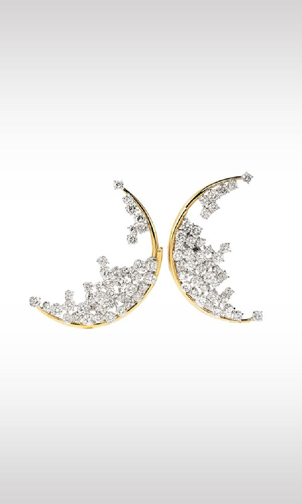 Blue Moon, 1996: the half moon, a very old jewelry motif and a dream symbol for excellence, is the inspiration for these earrings, dedicated to dreams. The part in yellow gold represents the lunar profile upon which sparkle 13.9 carats of diamonds set in white gold, which seem suspended in space. The particular closure of the earrings continues the motif into the rear of the lobe, producing an illusory effect that seems to challenge the laws of physics.