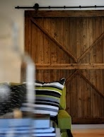 Love the idea of using an old barn door as a door in the house.