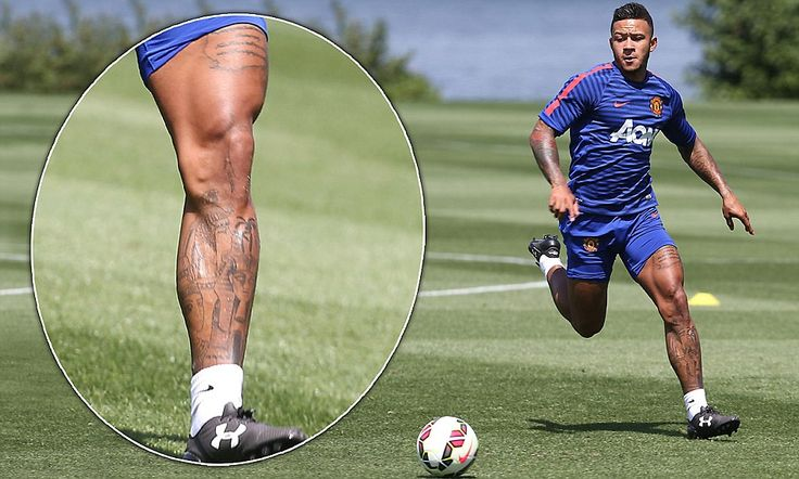 Memphis Depay shows off his muscular legs as he trains with Manchester United at the Virgi...