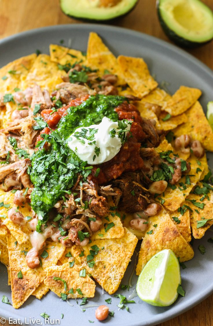 Crock Pot Pulled Pork Nachos with Chimichurri Sauce from @EatLiveRun