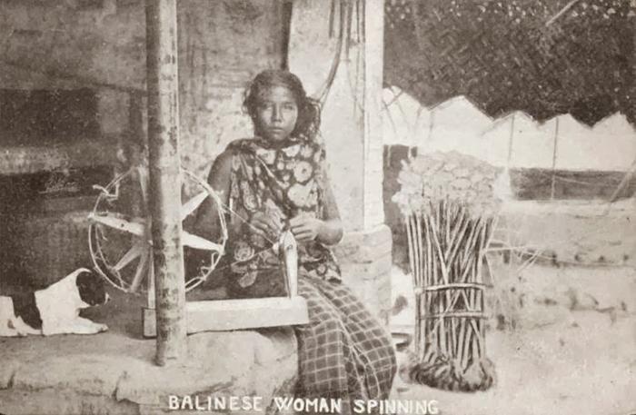 Balinese woman spinning thread, Bali. 1910.