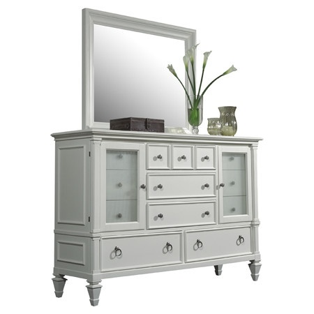 White wood cabinet with reeded glass doors and nickel hardware.   Product: DresserConstruction Material: Wood and...