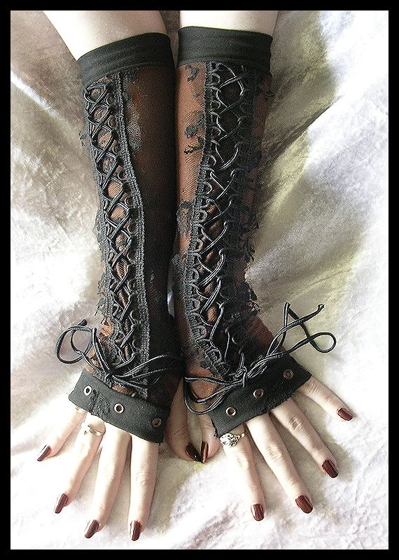 Steampunk arm warmers. (her nails aren't shabby either!)