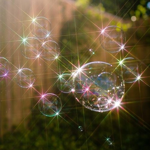 bubbles - what a great shot, I love the sparkles even if they were photoshopped (not saying they were, I don't know)