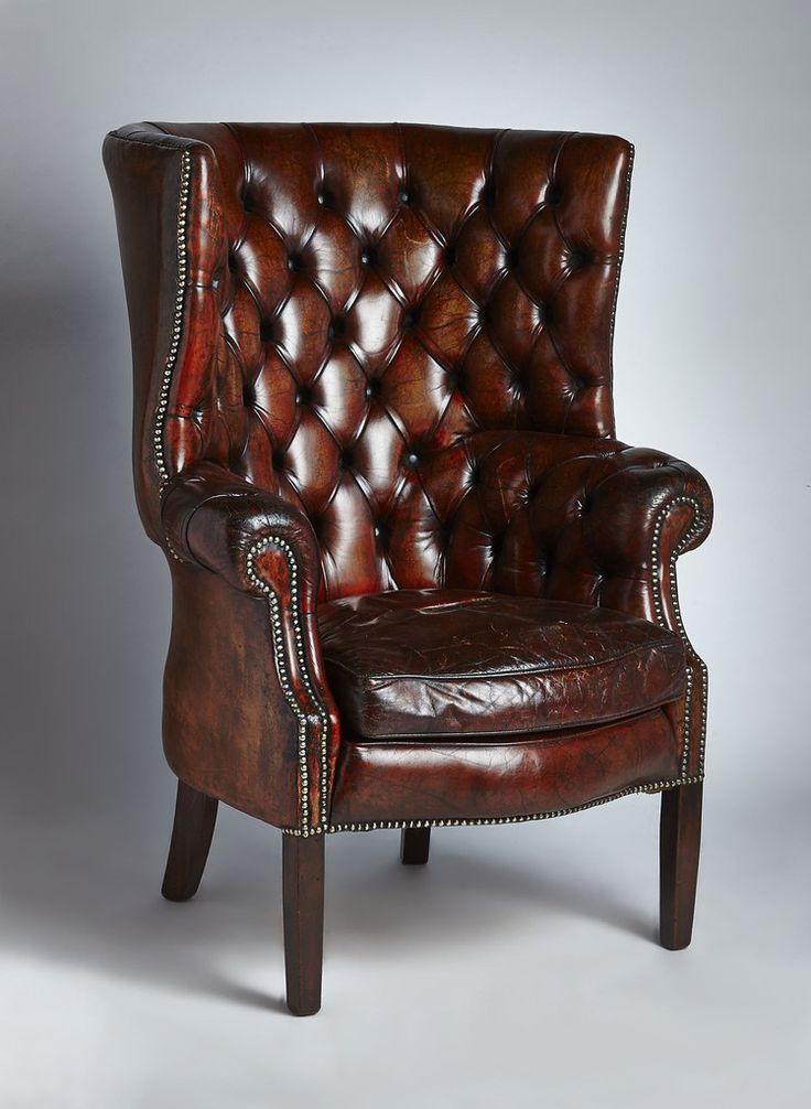 Spectacular English wing chair with great leather and patina. From the late 19th century.