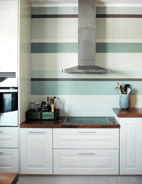 Green striped wall in a kitchen.: Mint Green, Kitchens Stripes Wall, Paintings Wall, Green Stripes, Mosaics Tile, White Cabinets, Stripes Kitchens Wall, Kitchens Hoods, Accent Wall