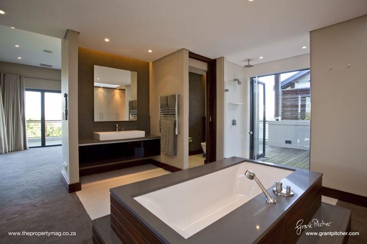 En-suite bathroom, wooden and granite bath, taps, wooden finishes