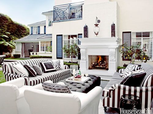 "Martyn Lawrence Bullard covered roll-arm sofas and chairs in Perennials fabrics for a black-and-white outdoor living room: ""I wanted it to look like indoor furniture had been dragged outside."""